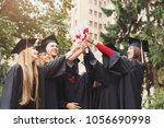 a group of multietnic graduate... | Shutterstock . vector #1056690998