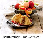 puff pastry wrapped apple with... | Shutterstock . vector #1056694025