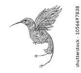 hummingbird flies on a white... | Shutterstock .eps vector #1056697838