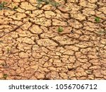 close up of cracked dry earth...   Shutterstock . vector #1056706712