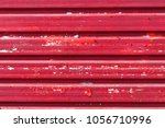 paint coming off a red metal... | Shutterstock . vector #1056710996