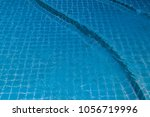 swimming pool with blue water | Shutterstock . vector #1056719996
