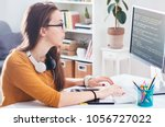 programmer working from home... | Shutterstock . vector #1056727022