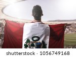 peruvian fan celebrating in the ... | Shutterstock . vector #1056749168