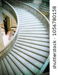 curvilinear stairs. upside view ... | Shutterstock . vector #1056780158