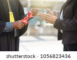 Small photo of Student is accomplish the university degree and get certificate to certify education.Dad mom or college is clap hand to congratulations.Copy space is locate center using for announcement quote