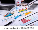 financial paper charts and... | Shutterstock . vector #105682352