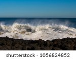 foaming white backwash from the ...   Shutterstock . vector #1056824852