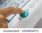 finger pressing start button on ... | Shutterstock . vector #1056856472