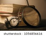 old three book clock magnifying ... | Shutterstock . vector #1056856616
