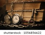 old book clock key on a wooden... | Shutterstock . vector #1056856622