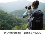 woman photographer taking photo ... | Shutterstock . vector #1056874202