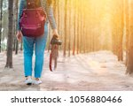 woman photographer walking in... | Shutterstock . vector #1056880466