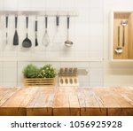 wood table top on blur kitchen... | Shutterstock . vector #1056925928