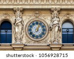 clock and statue on the... | Shutterstock . vector #1056928715
