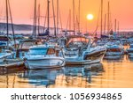 boats and yachts on the quay in ... | Shutterstock . vector #1056934865