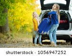 two adorable girls with a... | Shutterstock . vector #1056947252