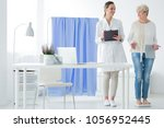 happy woman standing on a scale ...   Shutterstock . vector #1056952445