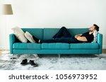 man sleeping on the sofa | Shutterstock . vector #1056973952