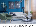 green armchair and couch in...