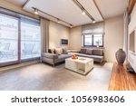 warm  luxurious living room... | Shutterstock . vector #1056983606
