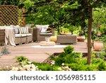 pouf on white round rug near... | Shutterstock . vector #1056985115