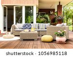Beige garden furniture with...