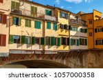 rear view of old buildings on... | Shutterstock . vector #1057000358
