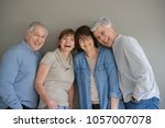 group of senior people ... | Shutterstock . vector #1057007078