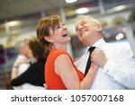 senior couple attending dance... | Shutterstock . vector #1057007168