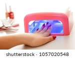 woman drying her nail polish... | Shutterstock . vector #1057020548