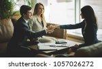 handshake of business partners... | Shutterstock . vector #1057026272