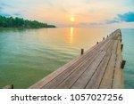 wood bridge or pier on the... | Shutterstock . vector #1057027256