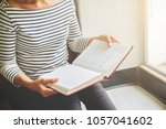 woman is reading and praying... | Shutterstock . vector #1057041602