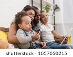 happy young family spending... | Shutterstock . vector #1057050215