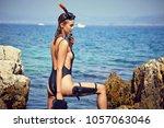 beautiful woman on a beach near ... | Shutterstock . vector #1057063046