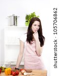 young woman wearing a apron in...