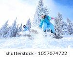 snowboarders on ski piste at... | Shutterstock . vector #1057074722