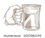 hands holding drink glass... | Shutterstock .eps vector #1057082195