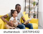 handsome father and little... | Shutterstock . vector #1057091432