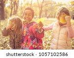 Little Girls Playing Fallen Leaves - Fine Art prints