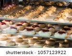 cakes and sweets on the counter ... | Shutterstock . vector #1057123922