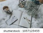 smartphone  coffee and notebook ... | Shutterstock . vector #1057125455