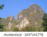 rock mountain and blue sky   Shutterstock . vector #1057141778