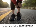 female runner touching sport... | Shutterstock . vector #1057177238