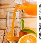 fresh orange juice meaning... | Shutterstock . vector #1057190282