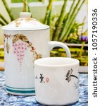 Small photo of Green Tea Cup Showing Refresh Breaktime And Teacups