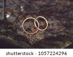 golden rings on wet stone after ... | Shutterstock . vector #1057224296