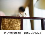 wedding fings on wooden mirror... | Shutterstock . vector #1057224326