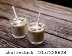 iced coffee in a glass with... | Shutterstock . vector #1057228628